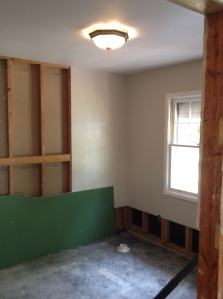 The small 12x15 bedroom that is about to become a bath! next door is the master bedroom with a 1/2 bath the size of a closet.